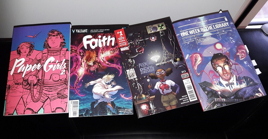 Cover der Comics Paper Girls Vol. 2, Faith 6, Moon Girl and Devil Dinosaur 13, One Week in the Library OGN