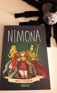 Comicband auf dem ein Mädchen mit Punkfrisur und Flügeln und zwei Helden abgebildet sind.