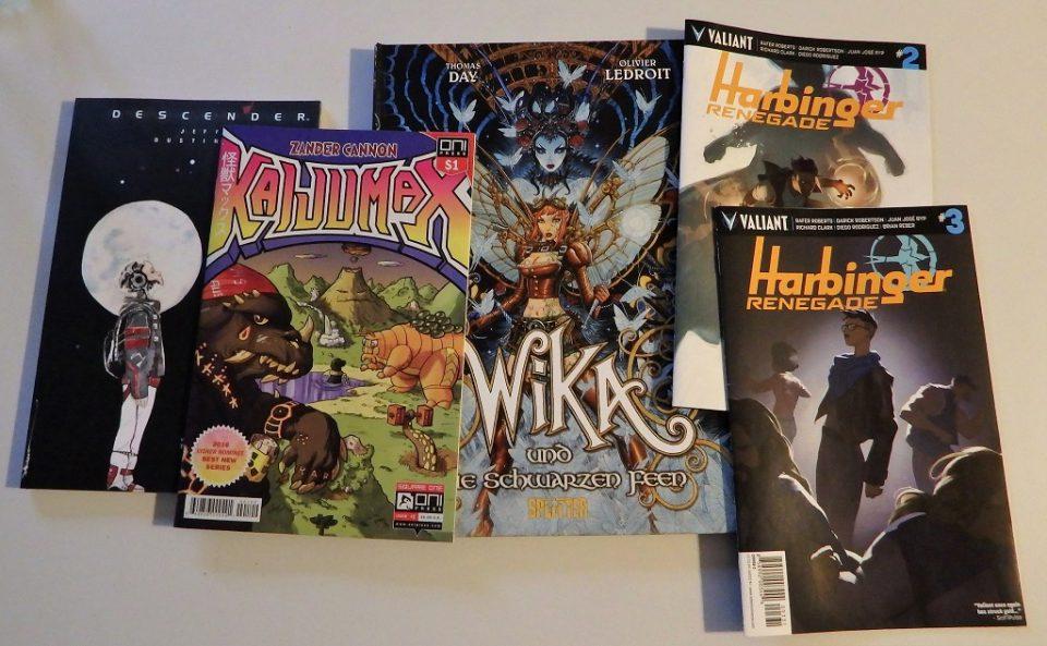 5 Comics nebeneinander ausgebreitet