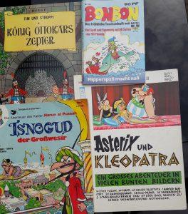 4 Comics der Serien Tim und Struppi, Bonbon Taschenhefte, Isnogud und Asterix