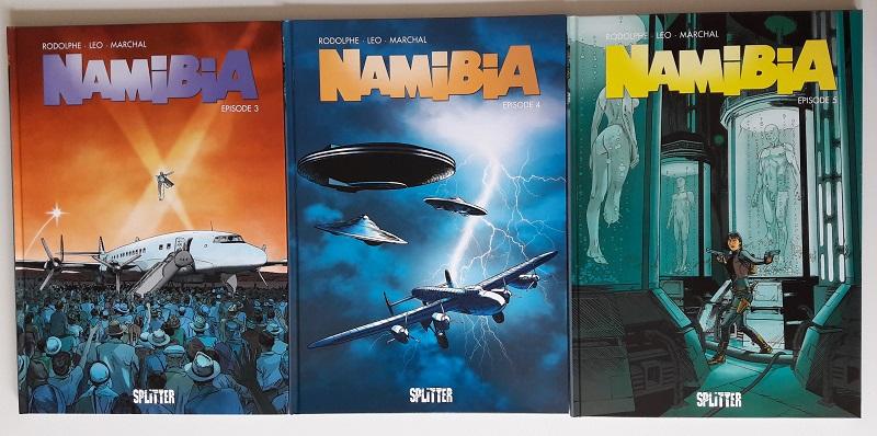 Drei Hardover-Comics nebeneinander, die jeweils den Titel Namibia tragen.