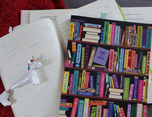 Notizbücher und ein Einhornkugelschreiber