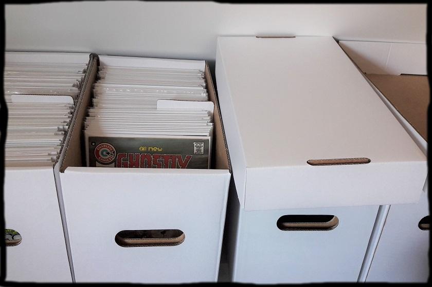 Drei Comicboxen mit Comics gefüllt