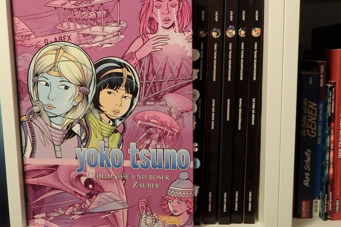 Yoko Tsuno Sammelband 9 hat einen rosa-lila Hintergrund und zeigt Yoko und Khany auf dem Cover