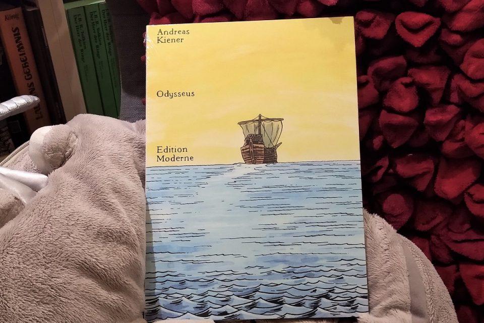 Odysseus gelber Comic vor einem Kissen