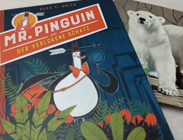 Pinguin mit Lupe in der Hand, einem Pfeil durch den Indy-Hut und einer Umhängetasche