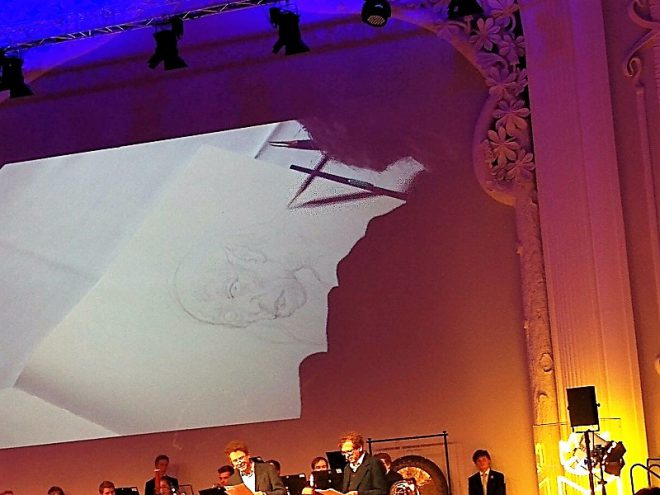 Großer Leipzig liest Abend: Herr der Ringe. John Howe zeichnet und man sieht es in einer Projektion an der Rückwand
