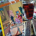 Comiccover daneben Wein und Kekse