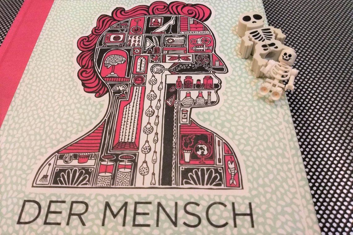 Cover auf dem ein menschlicher Kopf im Querschnitt als Illustration zu sehen ist, darauf zwei kleine Spielzeugskelette