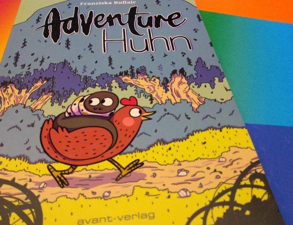Comic liegt auf einem regenbogenbunten Hintergrund
