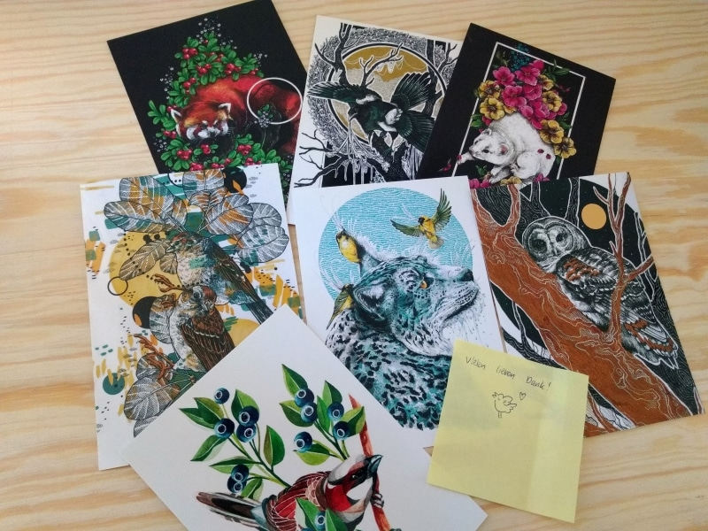 Postkarten, die Eulen, Wölfe, Vögel zeigen