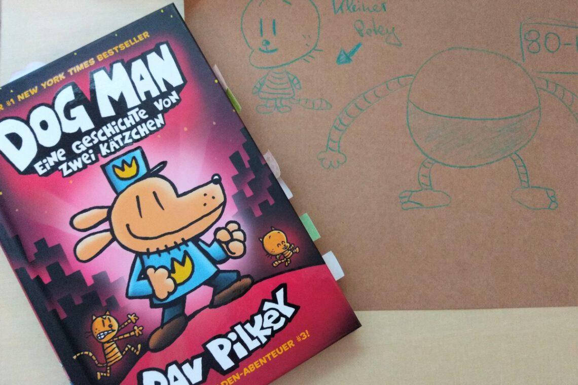 Comic zeigt den Polizisten mit Hundekopf, daneben eine Zeichnung auf braunem Papier