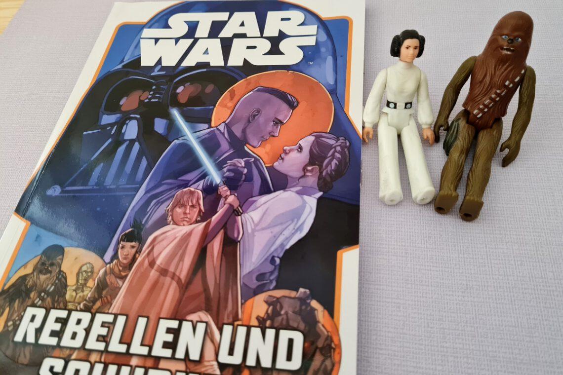 Star Wars Comic, daneben zwei alte Star Wars-Figuren: Leia und Chewi